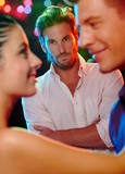 Fototapety Jealous man looking at dancing couple