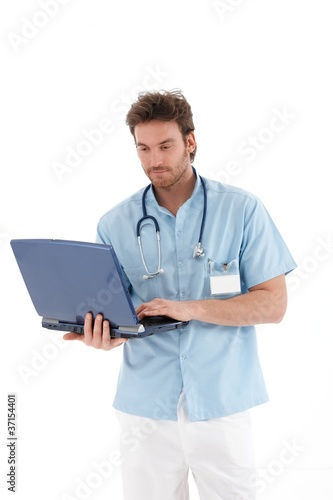 Young doctor working on laptop