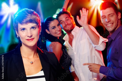 Young woman at a party looking outsider