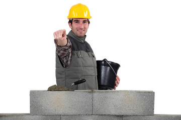 Bricklayer pointing ahead