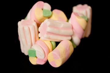 sweet colorful marshmallows on black background