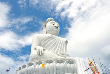 White Buddha and blue sky background