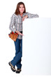 craftswoman holding a blank ad board