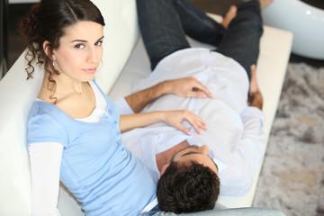 Man laying on girlfriend