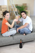 Couple drinking champagne after house move