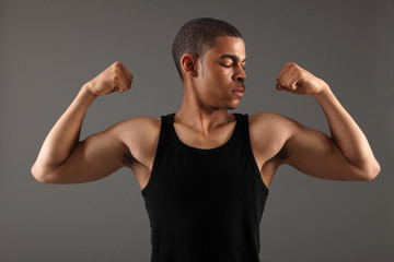 Fit body bicep muscles on african american man