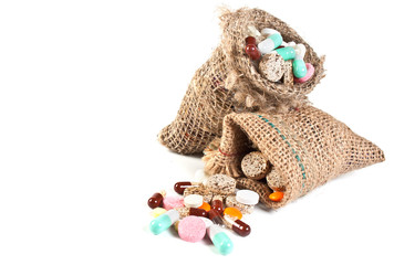 pills and vitamins in a linen sac