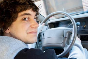 Teen boy driver behind the wheel