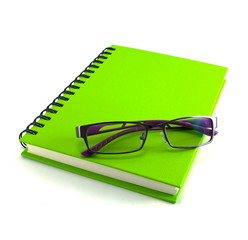 eyeglasses and notebook