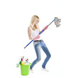 young blonde attractive woman with tools for housecleaning