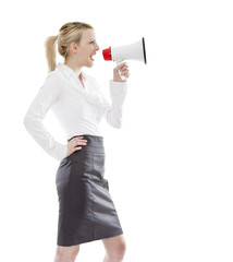 young blonde attractive business woman holding a megaphone