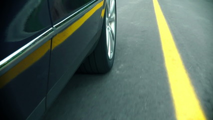 Car in motion - Wheel on the road
