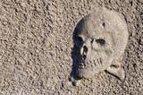 primitive skull and crossbones relief poster