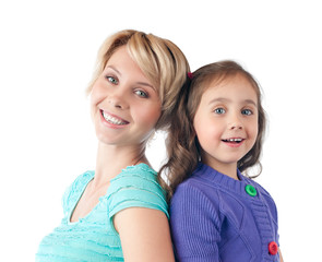 happy mother and daughter smiling in studio