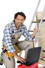 Happy laborer using computer