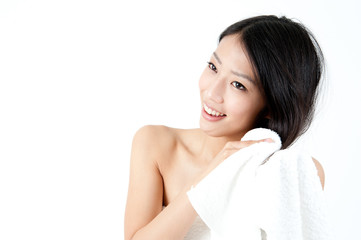 attractive asian woman washing her hair