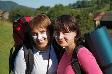 Tourists in sunscreen before hiking