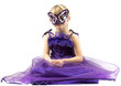 Little girl (6 years old) in purple dress and mask