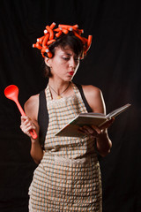 housewife with cookbook