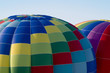 Top sections of hot-air balloons inflating or ascending