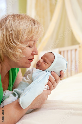 Portrait of mature woman and her newborn grandson