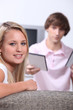 Teenagers watching DVD