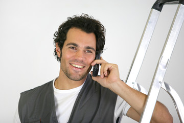 Handyman talking on his mobile phone