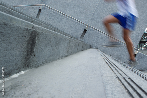 Fast Man running up stairs