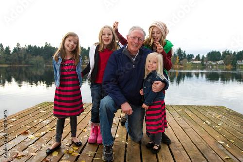 Happy Grandpa with a group of children