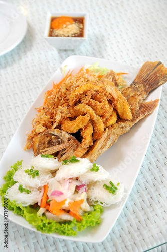 Fried fish on the white plate