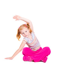 little girl stretching studio isolated on white background