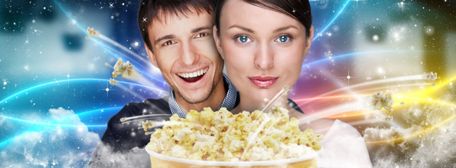 Portrait of young stylish modern couple watching movie at cinema