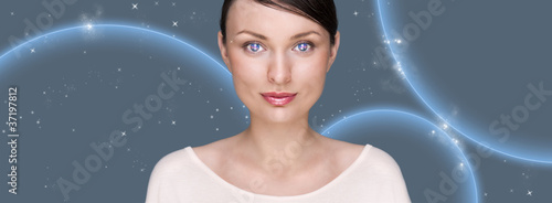 Portrait of beautiful futuristic style woman looking at camera a