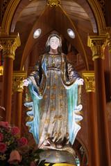 Mary statue near the shrine in church.