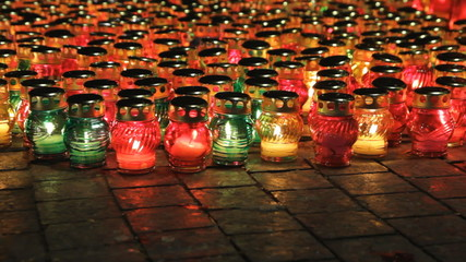 Many glass candles. Memorial Day   in Ukraine.