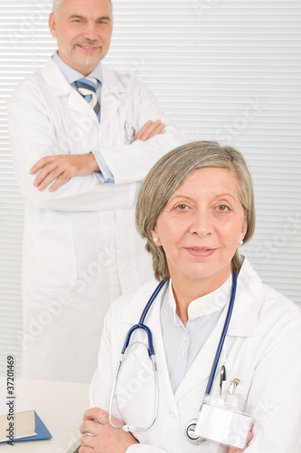 Medical team doctors by desk work computer