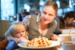 Beautiful woman with baby in cafe