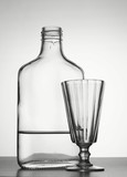 Alcoholism. Bottle with vodka and liquor-glass poster
