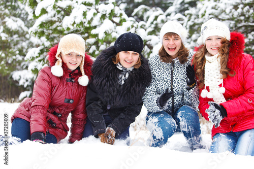 Cheerful girls on snow