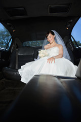 Bride With Flower Bouquet in Limo