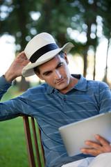 Man Looking at Tablet PC Screen