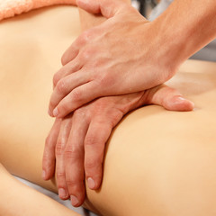 hands of masseur massaging woman