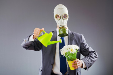 Businessman with gas mask and flowers