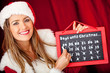 Female Santa counting days for Christmas