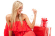 Young blonde woman sitting with Christmas presents