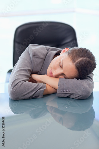 Portrait of a tired businesswoman sleeping