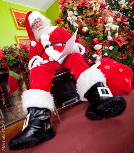 Santa asleep with a wish list