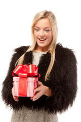 Surprised young woman with a present
