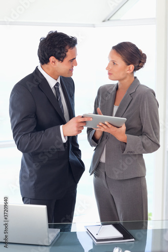 Business partner standing with tablet in their hands