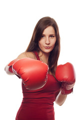 Confident young woman with boxing gloves